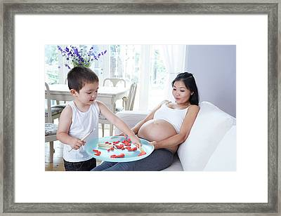 Pregnant Woman Playing With Son Framed Print by Ruth Jenkinson