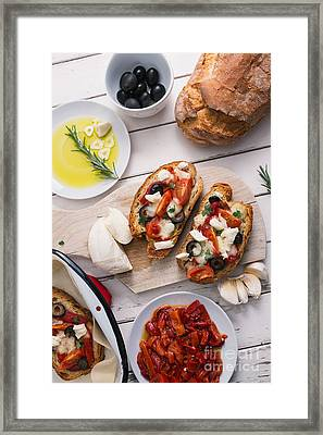 Preparing Bruschetta Framed Print by Viktor Pravdica