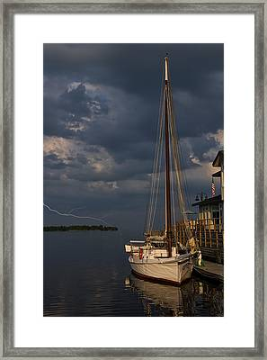 Preparing For The Storm Framed Print by Chris Flees