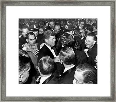 President John F. Kennedy In The Thick Of The Crowd Framed Print