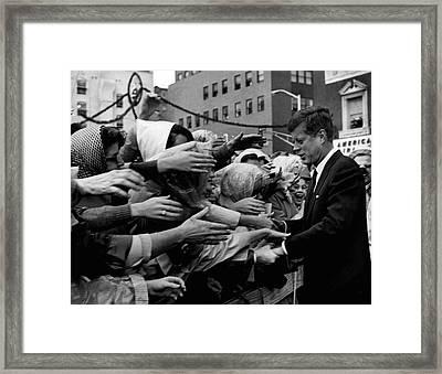 President John F. Kennedy Shaking Hands Framed Print
