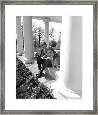 President Kennedy And John-john Framed Print