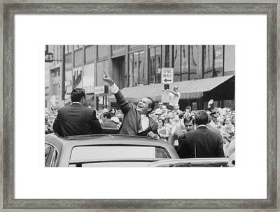 President Nixon Pointing At The Crowd Framed Print by Everett