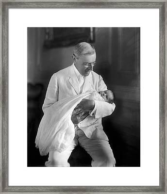 President Wilson Holding Baby Framed Print