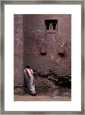 Priest Praying Outside Church In Lalibela Ethiopia Framed Print