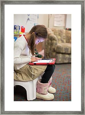 Primary School Girl Using Tablet Framed Print
