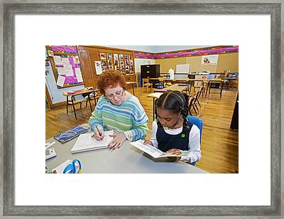 Primary School Reading Lesson Framed Print by Jim West