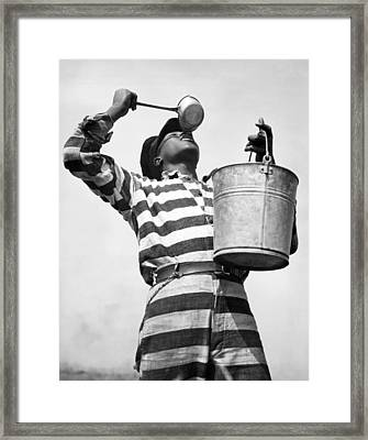 Prisoner Quenches His Thirst Framed Print by Underwood Archives