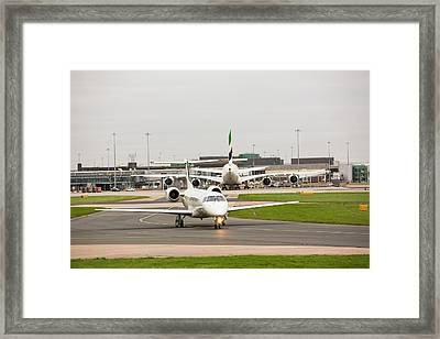 Private Jet At Manchester Airport Framed Print by Ashley Cooper