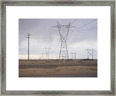 Procession Of Giants Framed Print by Angela Stout