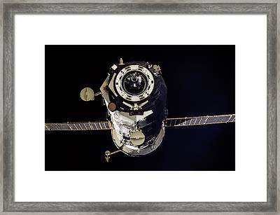 Progress 50 Departing The Iss Framed Print by Nasa