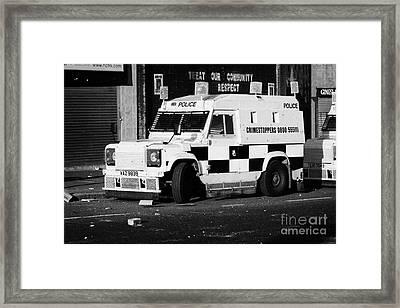 Psni Armoured Land Rover On Crumlin Road At Ardoyne Shops Belfast 12th July Framed Print by Joe Fox