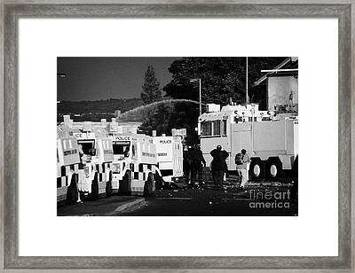 Psni Armoured Land Rovers And Water Canon On Crumlin Road At Ardoyne Shops Belfast 12th July Framed Print by Joe Fox