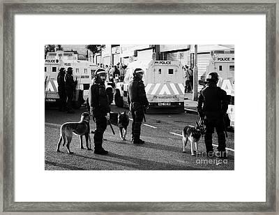 Psni Dog Handlers In Riot Gear And Dogs On Crumlin Road At Ardoyne Shops Belfast 12th July Framed Print by Joe Fox