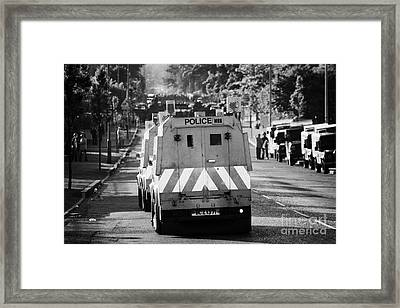 Psni Land Rovers Head Up The Crumlin Road Towards Loyalists At Ardoyne Shops Belfast 12th July Framed Print by Joe Fox