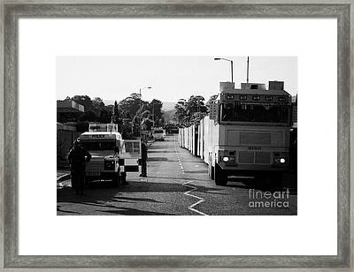 Psni Landrover And Watercannon In Wait In Preparation On Crumlin Road At Ardoyne Shops Belfast 12th  Framed Print by Joe Fox