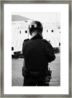Psni Officer In Riot Gear On Crumlin Road At Ardoyne Shops Belfast 12th July Framed Print by Joe Fox