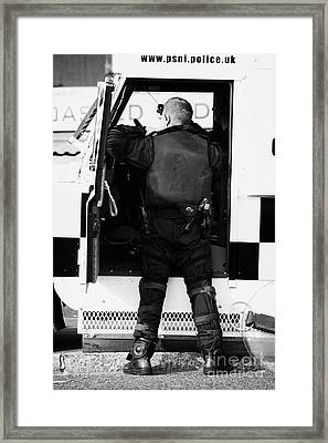 Psni Officer Puts On Protective Ruiot Gear On Crumlin Road At Ardoyne Shops Belfast 12th July Framed Print by Joe Fox