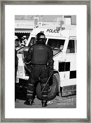 Psni Officer With Riot Gear And Baton In Front Of Land Rover On Crumlin Road At Ardoyne Shops Belfas Framed Print by Joe Fox