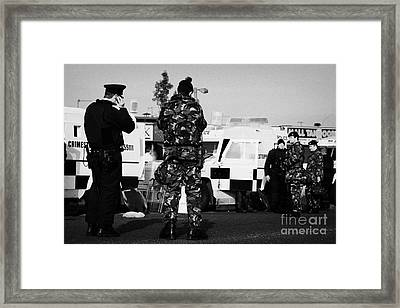 Psni Officers And British Army Soldiers At Psni Landrovers On Crumlin Road At Ardoyne Shops Belfast  Framed Print by Joe Fox