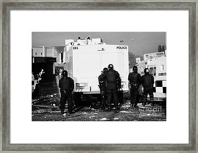Psni Officers Behind Water Canon During Riot On Crumlin Road At Ardoyne Shops Belfast 12th July Framed Print by Joe Fox
