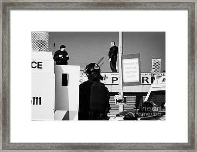 Psni Officers In Protective Riot Gear At Landrovers And Snipers On Crumlin Road At Ardoyne Shops Bel Framed Print by Joe Fox