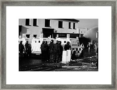 Psni Officers Watch Rioters Being Hit By Water Canon On Crumlin Road At Ardoyne Shops Belfast 12th J Framed Print by Joe Fox