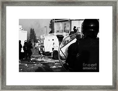 Psni Riot Officer With Baton Round Warning On Shield Watches Rioting On Crumlin Road At Ardoyne Shop Framed Print by Joe Fox