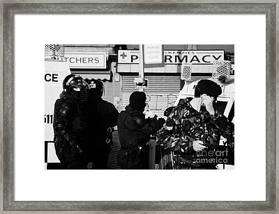 Psni Riot Officers And British Soldier On Crumlin Road At Ardoyne Shops Belfast 12th July Framed Print by Joe Fox
