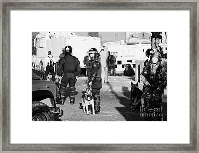 Psni Riot Officers And Dog Handler And Armed Soldiers On Crumlin Road At Ardoyne Shops Belfast 12th  Framed Print by Joe Fox