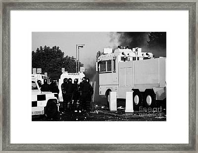 Psni Riot Officers Behind Armoured Land Rover And Water Cannon On Crumlin Road At Ardoyne Shops Belf Framed Print by Joe Fox