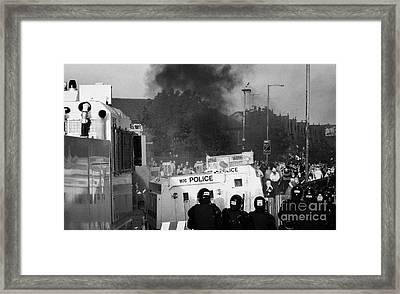 Psni Riot Officers Face Rioters Mob And Burning Vehicle On Crumlin Road At Ardoyne Shops Belfast 12t Framed Print by Joe Fox