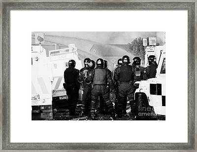 Psni Riot Officers Watch Rioting And Water Canon On Crumlin Road At Ardoyne Shops Belfast 12th July Framed Print by Joe Fox