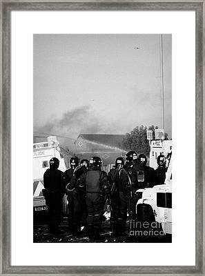 Psni Riot Officers Watch Rioting On Crumlin Road At Ardoyne Shops Belfast 12th July Framed Print by Joe Fox
