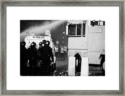 Psni Riot Police Behind Armoured Land Rover And Water Canon Face On Crumlin Road At Ardoyne Framed Print by Joe Fox