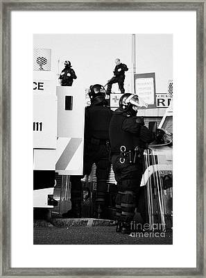 Psni Riot Squad Officers In Protective Gear And Snipers On Crumlin Road At Ardoyne Shops Belfast 12t Framed Print by Joe Fox