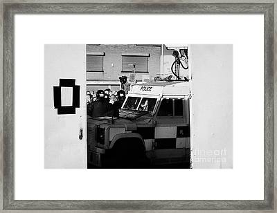 Psni Surveillance Land Rover Watches Crowd On Crumlin Road At Ardoyne Shops Belfast 12th July Framed Print by Joe Fox