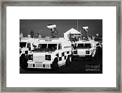 Psni Surveillance Landrovers With Cameras On Crumlin Road At Ardoyne Shops Belfast 12th July Framed Print by Joe Fox
