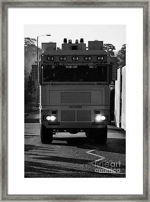 Psni Water Canon On Crumlin Road At Ardoyne Shops Belfast 12th July Framed Print by Joe Fox