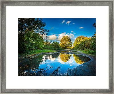Framed Print featuring the photograph Puddles. by Gary Gillette