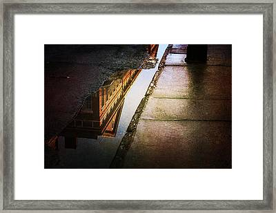 Puddles Of The Past Framed Print by Heather Green