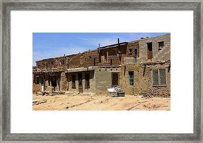 Pueblo Yard Sale Framed Print by Joe Kozlowski