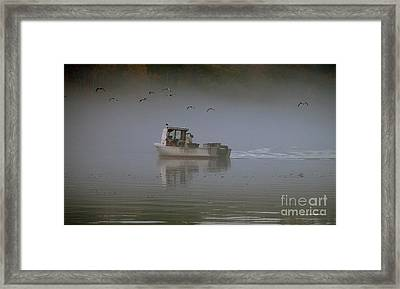 Pulling Traps Framed Print by Christopher Mace
