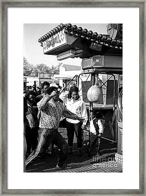 Punching Ball Framed Print by Neil Pollick