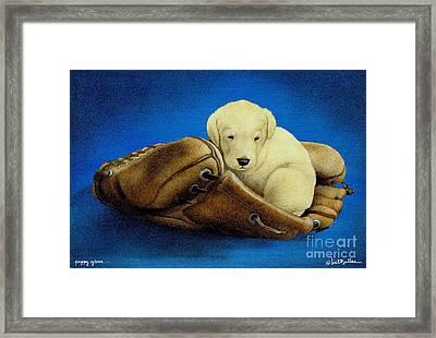 Puppy Glove... Framed Print