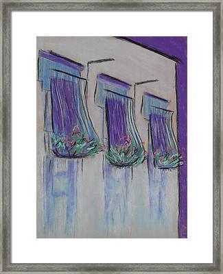 Purple Balconies Framed Print by Marcia Meade