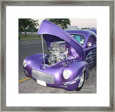 Purple Monster Framed Print by John Telfer