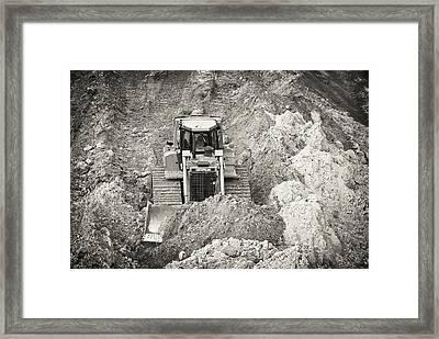 Pushing Dirt Framed Print by Patrick M Lynch