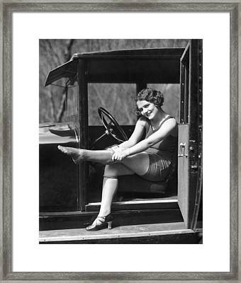Putting On Rolled Stockings Framed Print