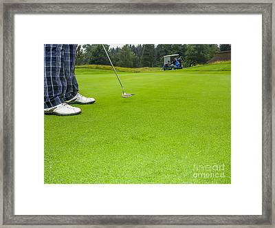 Putting Framed Print